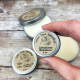 Grass-fed Tallow Salve, 1/2 Ounce Tin, Held in Fingers to Show Scale